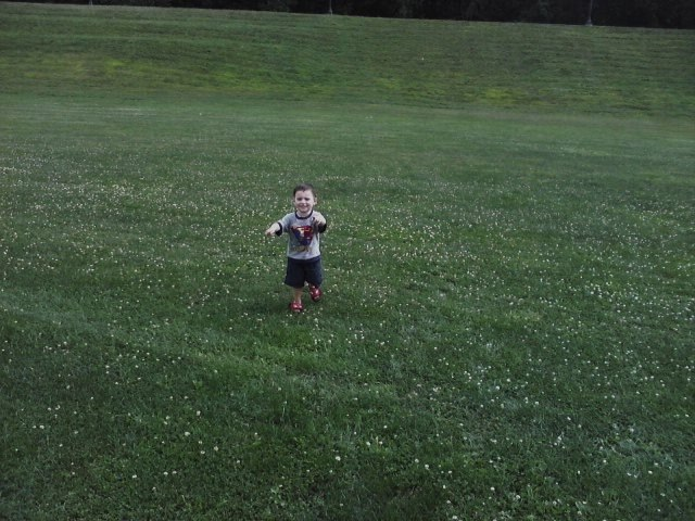 Photo of little boy running in God's backyard copyright 2013 - 2020 by Marion Weiscarger Roughsedge of Nippies Magazine - nippies.com. All rights reserved.